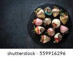 sweet strawberries in chocolate ...   Shutterstock . vector #559916296