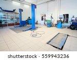 lift in an empty car repair... | Shutterstock . vector #559943236