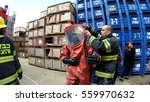 Small photo of YESUD HAMAALA ISRAEL, MARCH 21, 2016: Firefighters practice sealing of leak accident from corrosive toxic hazardous material Ammonia liquid container in fruit factory dressing protective suites.