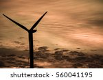 sunset showing wind turbine... | Shutterstock . vector #560041195