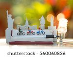 miniature people on bike and... | Shutterstock . vector #560060836