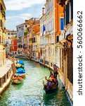 tourists traveling in gondola.... | Shutterstock . vector #560066662