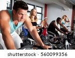 young people at the gym | Shutterstock . vector #560099356