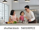 asian family cooking at kitchen | Shutterstock . vector #560100922