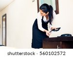 room maid looking through hotel ... | Shutterstock . vector #560102572