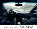 driving a car on winter road.... | Shutterstock . vector #560108668