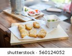 chicken nuggets and sauce on a... | Shutterstock . vector #560124052