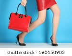 sexy female legs in high heels... | Shutterstock . vector #560150902