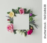 Creative layout with colorful flowers, leaves and copy space card note. Nature concept. Flat lay.