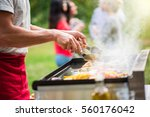 close up on hands grilling... | Shutterstock . vector #560176042