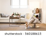 young woman reading a book and... | Shutterstock . vector #560188615