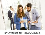business colleagues using... | Shutterstock . vector #560208316
