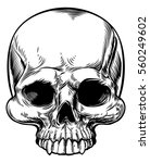 skull in a vintage retro hand... | Shutterstock .eps vector #560249602