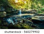 landscape of peaceful waterfall ... | Shutterstock . vector #560279902