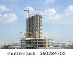 building site with cranes and... | Shutterstock . vector #560284702