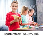 kid playing with paper plane ... | Shutterstock . vector #560292406