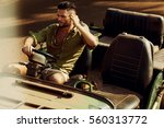 handsome man in the jeep on the ... | Shutterstock . vector #560313772
