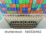 Small photo of stack of containers aboard large cargo ship