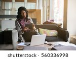 african american woman typing... | Shutterstock . vector #560336998