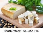 smoked soy cheese tofu diced on ... | Shutterstock . vector #560355646