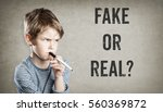 fake or real  boy considering... | Shutterstock . vector #560369872