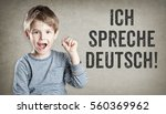 boy says he speaks german  on... | Shutterstock . vector #560369962