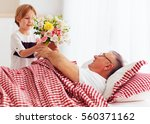 young grandson with flower... | Shutterstock . vector #560371162