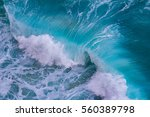 aerial view of crashing waves | Shutterstock . vector #560389798