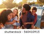 parents giving their kids... | Shutterstock . vector #560410915