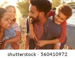 parents giving their kids... | Shutterstock . vector #560410972