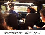 excited family on a road trip... | Shutterstock . vector #560422282