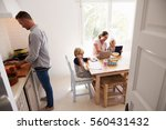 dad cooking and mum with kids... | Shutterstock . vector #560431432