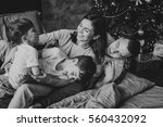 mother  father and two sons  on ... | Shutterstock . vector #560432092