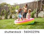 children having fun in garden... | Shutterstock . vector #560432596