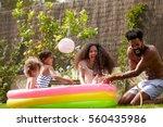 family having fun in garden... | Shutterstock . vector #560435986