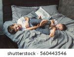 two brothers are playing on the ... | Shutterstock . vector #560443546