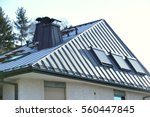 modern steel roof with roof... | Shutterstock . vector #560447845