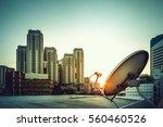 satellite dish in sunset  city... | Shutterstock . vector #560460526