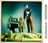 Small photo of Vintage Kenner Star Wars figures Han Solo, Chewbacca the Wookiee and a GNK Gonk Power Droid atop the Millennium Falcon, recreating a scene on Hoth from The Empire Strikes Back - filtered image