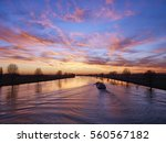 Small photo of Sunset view from the bridge of the town of Heusden on the river Bergsche Maas in the province Noord-Brabant, the Netherlands