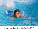 boy swimming and playing in a... | Shutterstock . vector #560624416