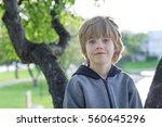 portrait of a boy playing in a...   Shutterstock . vector #560645296