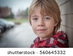 portrait of a boy with blurred... | Shutterstock . vector #560645332