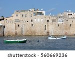 boats floating near the wall of ...   Shutterstock . vector #560669236