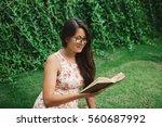 young mixed race  asian girl... | Shutterstock . vector #560687992