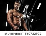 bodybuilder posing in the gym | Shutterstock . vector #560722972