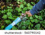boy hand try to turn off water... | Shutterstock . vector #560790142