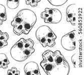 seamless pattern with skulls.... | Shutterstock .eps vector #560853922