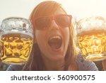girl drinking beer outdoors.  | Shutterstock . vector #560900575