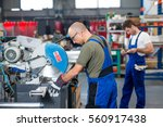 two worker in factory on the... | Shutterstock . vector #560917438